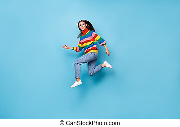 Full length body size profile side view of her she nice attractive pretty lovely cheerful cheery girl jumping running fast speed marathon isolated blue pastel color background