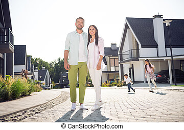 Full length body size view of four lovely cheery people family hugging move new home buying american dream in cottage town outdoor