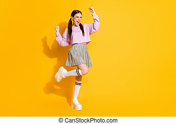 Full length body size view of her she nice attractive lovely charming cheerful glad girl dancing having fun celebrating isolated on bright vivid shine vibrant yellow color background