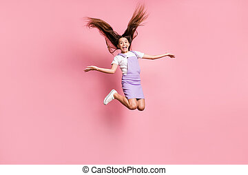 Full length body size view of her she nice attractive lovely charming pretty glad cheerful cheery girl jumping having fun fooling isolated over pink pastel color background