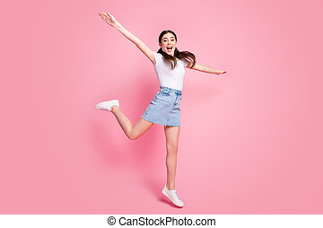 Full length body size view of her she nice attractive lovely charming pretty slender cheerful cheery girl jumping having fun walking isolated over pink pastel color background