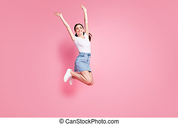 Full length body size view of her she nice attractive lovely charming pretty winsome cheerful cheery girl jumping having fun rising hands up isolated over pink pastel color background