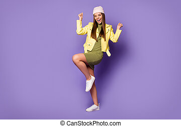 Full length body size view of her she nice attractive lovely fashionable overjoyed cheerful cheery girl dancing having fun isolated over bright vivid shine vibrant lilac purple violet color background