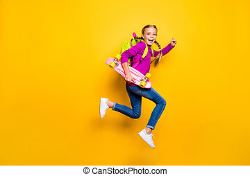 Full length body size view of her she nice attractive lovely glad cheerful cheery girl jumping running carrying skateboard isolated over bright vivid shine vibrant yellow color background