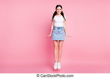 Full length body size view of her she nice attractive lovely pretty charming slim fit thin slender cheerful cheery girl posing jumping having fun isolated over pink pastel color background