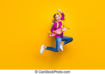 Full length body size view of her she nice attractive lovely pretty cheerful cheery girl jumping carrying longboard rejoicing isolated on bright vivid shine vibrant yellow color background