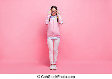 Full length body size view of her she nice attractive lovely pretty cute smart clever cheerful cheery girl geek wearing touching specs isolated over pink pastel color background
