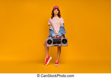 Full length body size view of her she nice attractive lovely pretty flirty cheerful girl carrying boombox sending air kiss posing isolated on bright vivid shine vibrant yellow color background