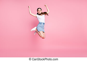 Full length body size view of her she nice attractive lovely pretty glad slim fit thin cheerful cheery girl jumping having fun celebrating isolated over pink pastel color background