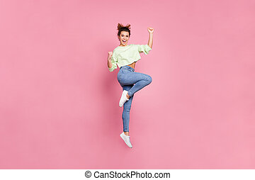 Full length body size view of her she nice attractive lovely pretty slender energetic cheerful cheery girl jumping rejoicing having fun isolated over pink pastel color background