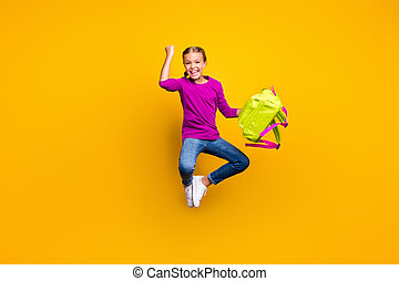 Full length body size view of her she nice attractive lovely successful cheerful cheery girl jumping carrying bag having fun rejoicing isolated on bright vivid shine vibrant yellow color background