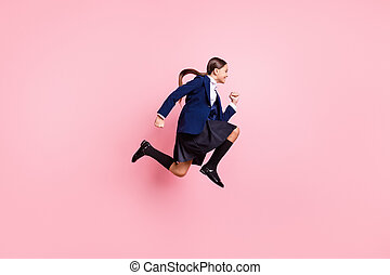 Full length body size view of her she nice attractive motivated cheerful cheery small little girl jumping running rush 1 September lesson isolated over pink pastel color background