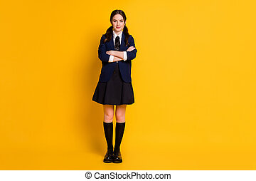 Full length body size view of her she nice attractive pretty charming cheery content schoolgirl folded arms back to learn isolated on bright vivid shine vibrant yellow color background
