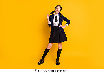 Full length body size view of her she nice attractive pretty charming cute dreamy cheerful cheery schoolgirl learning fantasizing isolated on bright vivid shine vibrant yellow color background