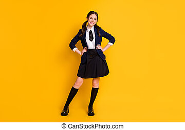 Full length body size view of her she nice attractive pretty cheerful cheery content schoolgirl posing wearing jacket isolated on bright vivid shine vibrant yellow color background