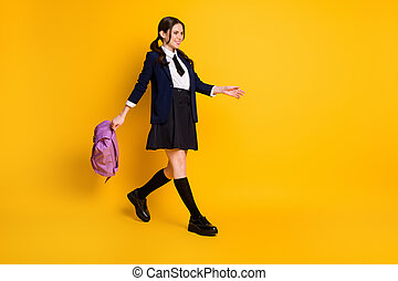Full length body size view of her she nice attractive pretty cheerful cheery schoolgirl nerd going back to school carrying violet bag isolated bright vivid shine vibrant yellow color background