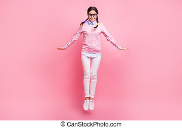 Full length body size view of her she nice attractive pretty cute cheerful cheery brown-haired teen girl jumping enjoying freedom having fun isolated pink pastel color background