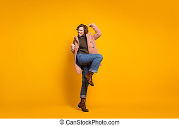 Full length body size view of her she nice attractive pretty fashionable overjoyed crazy cheerful cheery girl celebrating accomplishment isolated on bright vivid shine vibrant yellow color background