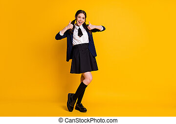 Full length body size view of her she nice attractive pretty glad cheerful cheery schoolgirl showing two double thumbup advert ad isolated on bright vivid shine vibrant yellow color background