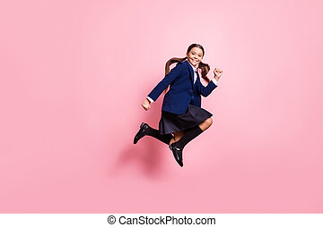 Full length body size view of her she nice attractive pretty glad cheerful cheery small little girl jumping running rush first lesson isolated over pink pastel color background