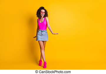 Full length body size view of her she nice attractive pretty glad cheerful wavy-haired girl walking having fun isolated on bright vivid shine vibrant yellow color background