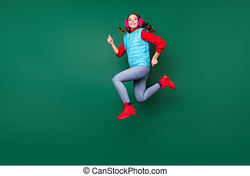Full length body size view of her she nice attractive pretty lovely cheerful cheery active girl jumping running wearing casual season coat isolated over green pastel color background