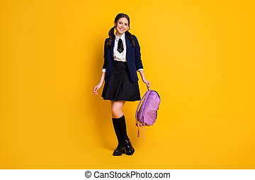 Full length body size view of her she nice attractive pretty lovely cheerful cheery schoolgirl nerd holding in hand lilac bag isolated on bright vivid shine vibrant yellow color background