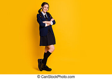Full length body size view of her she nice attractive pretty lovely cheerful cheery schoolgirl folded arms diligent learner isolated on bright vivid shine vibrant yellow color background