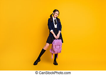 Full length body size view of her she nice attractive pretty smart clever cheerful schoolgirl nerd holding in hand violet bag 1 September isolated on bright vivid shine vibrant yellow color background
