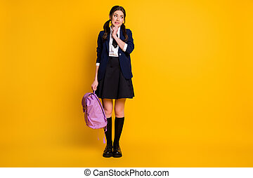Full length body size view of her she nice attractive shy modest unsure schoolgirl holding in hand violet bag 1 September back to school isolated on bright vivid shine vibrant yellow color background