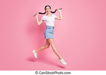 Full length body size view of her she nice-looking attractive lovely charming cheerful cheery crazy girl jumping fooling having fun isolated over pink pastel color background