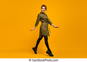 Full length body size view of her she nice-looking attractive lovely pretty charming fashionable glad cheerful cheery girl going isolated on bright vivid shine vibrant yellow color background