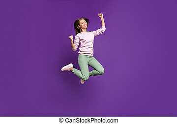 Full length body size view of her she nice lovely slim fit cheerful cheery girl jumping celebrating attainment having fun isolated on bright vivid shine vibrant purple violet lilac color background