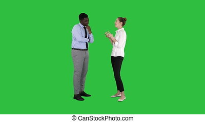 Business woman giving some ideas to her boss on a Green Screen, Chroma Key.