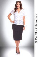 full length . business woman in office clothes.
