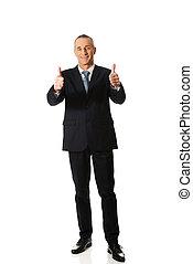 Full length businessman gesturing ok sign