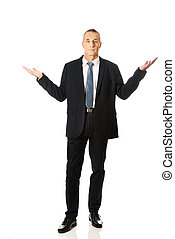 Full length businessman in undecided gesture