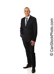 Full length businessman with hand in pocket