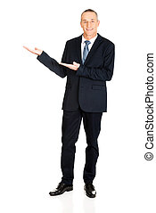Full length businessman with welcome gesture