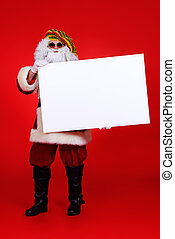 Casual Santa Claus hippie holds white board over festive red background.