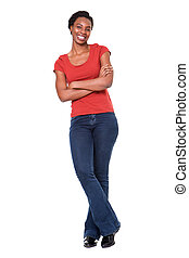 Full length confident african american woman standing with arms crossed against isolated white background