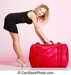 Full length elegant lady in voyage, traveler woman with old red bag