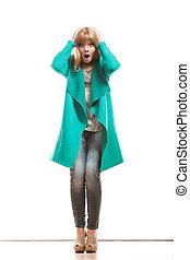Full length fashion woman in green coat.