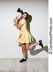 Full length image of crazy playful zombie woman in dress
