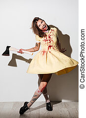 Full length image of mad happy zombie woman moving