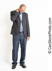 Full length mature Indian businessman shoulder pain