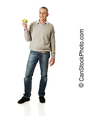 Full length mature man with an apple