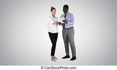 Modern business people working on a tablet on gradient background.