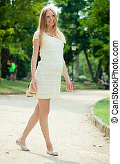 9 months pregnant woman walking on street