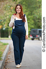 pregnant woman walking on street